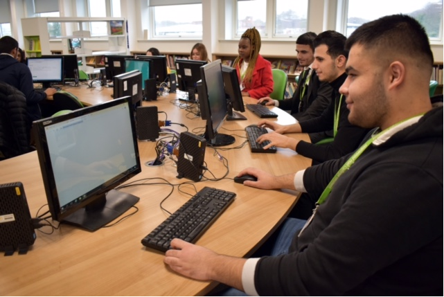 Learners studying in a computer room at Hopwood Hall College