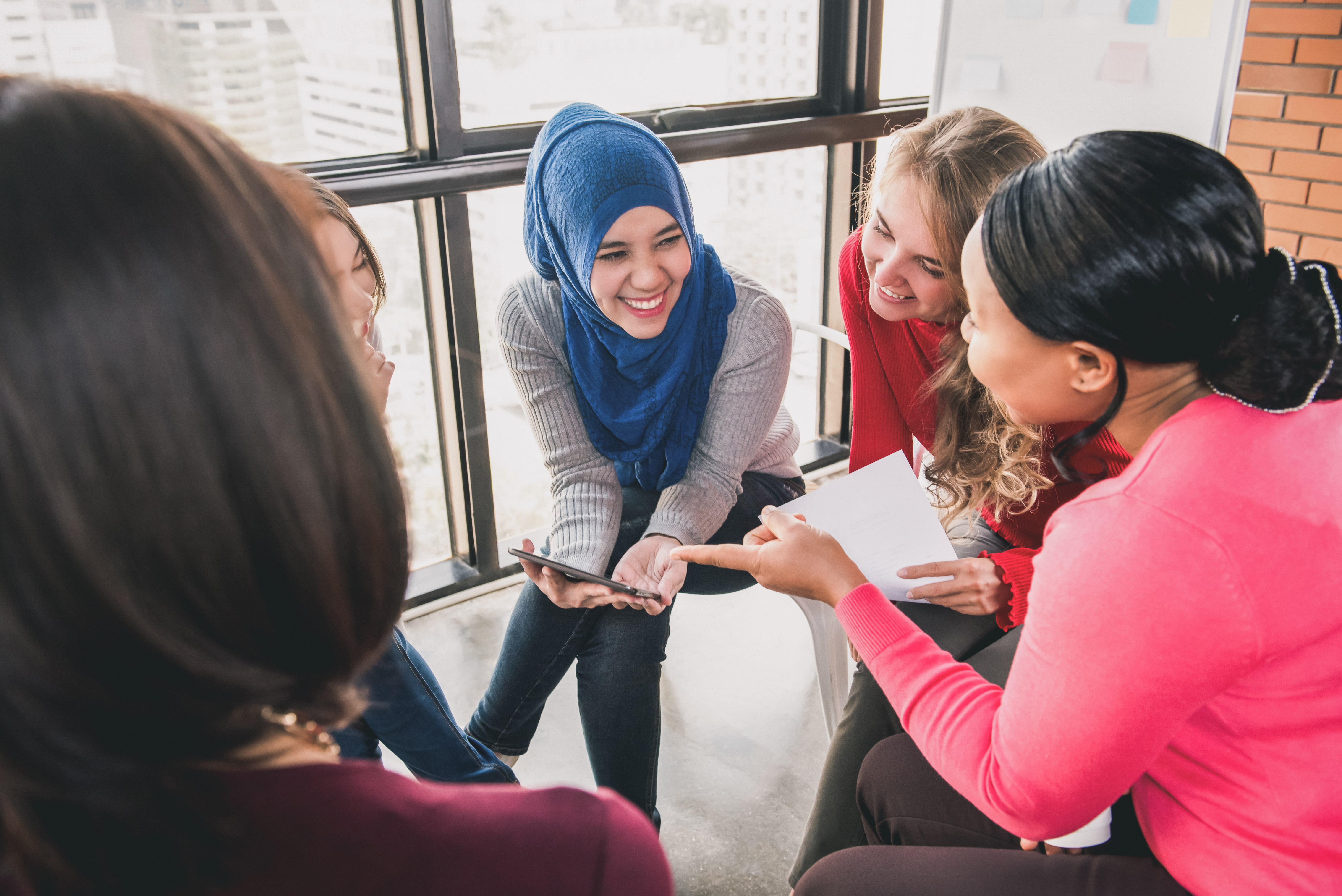 Group of people chatting in a community centre