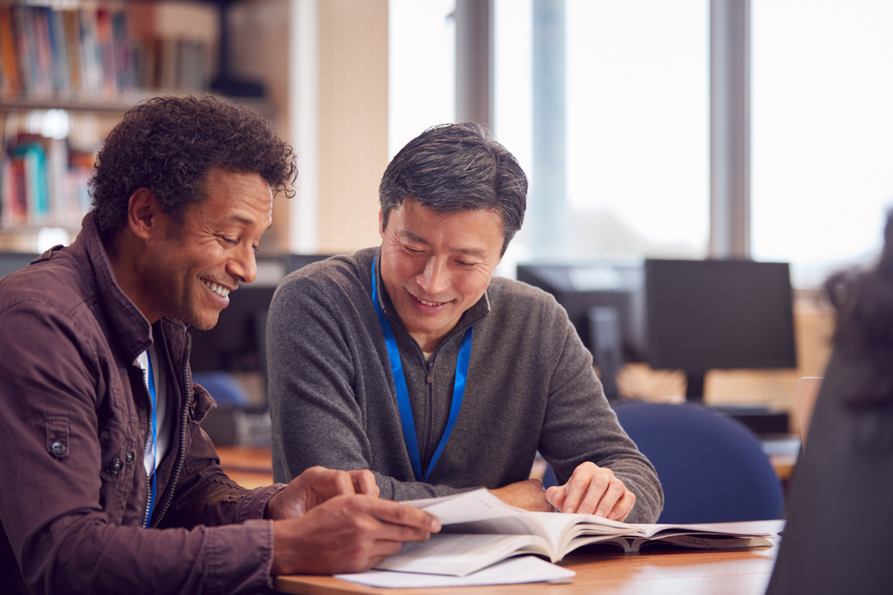 Two learners studying at Bury Adult Learning