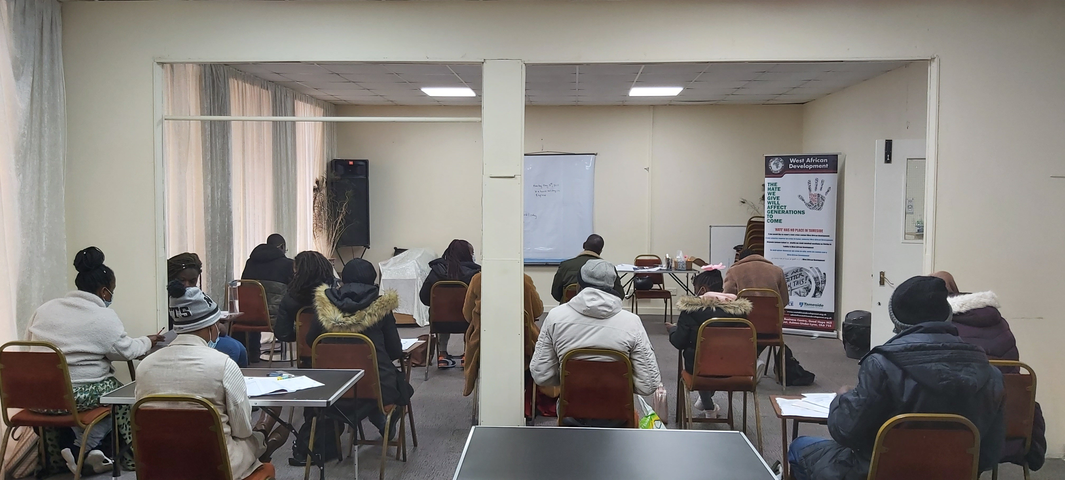 Learners studying in a classroom at West African Development