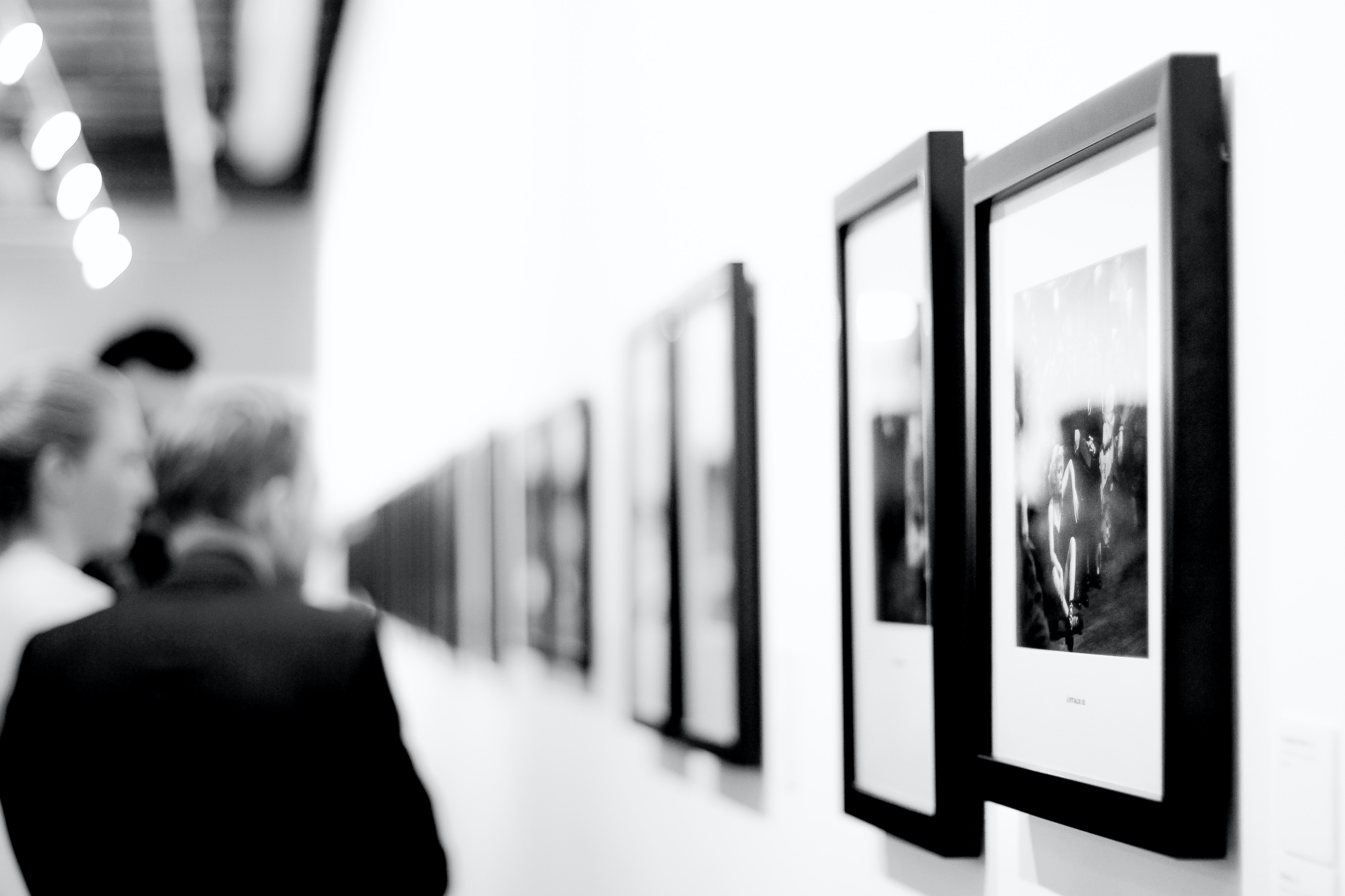 People looking at photographs displayed at Bury Fusilier Museum