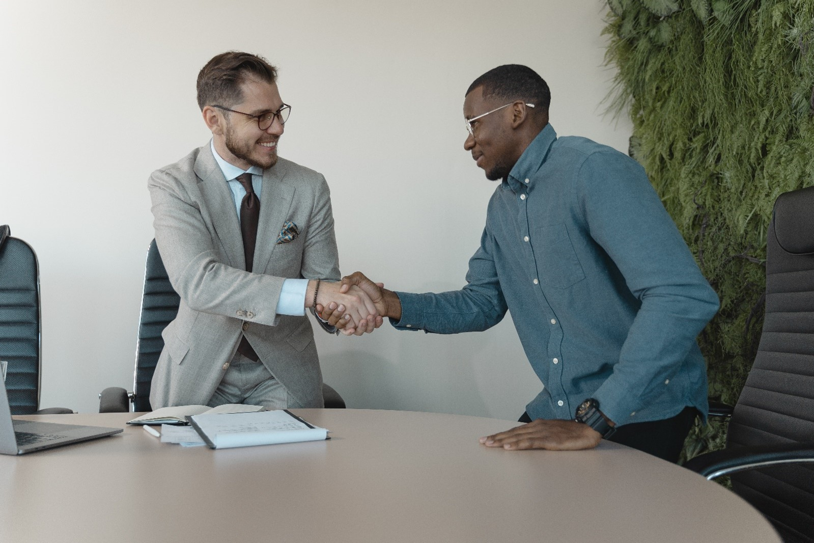Two people shaking hands in an office