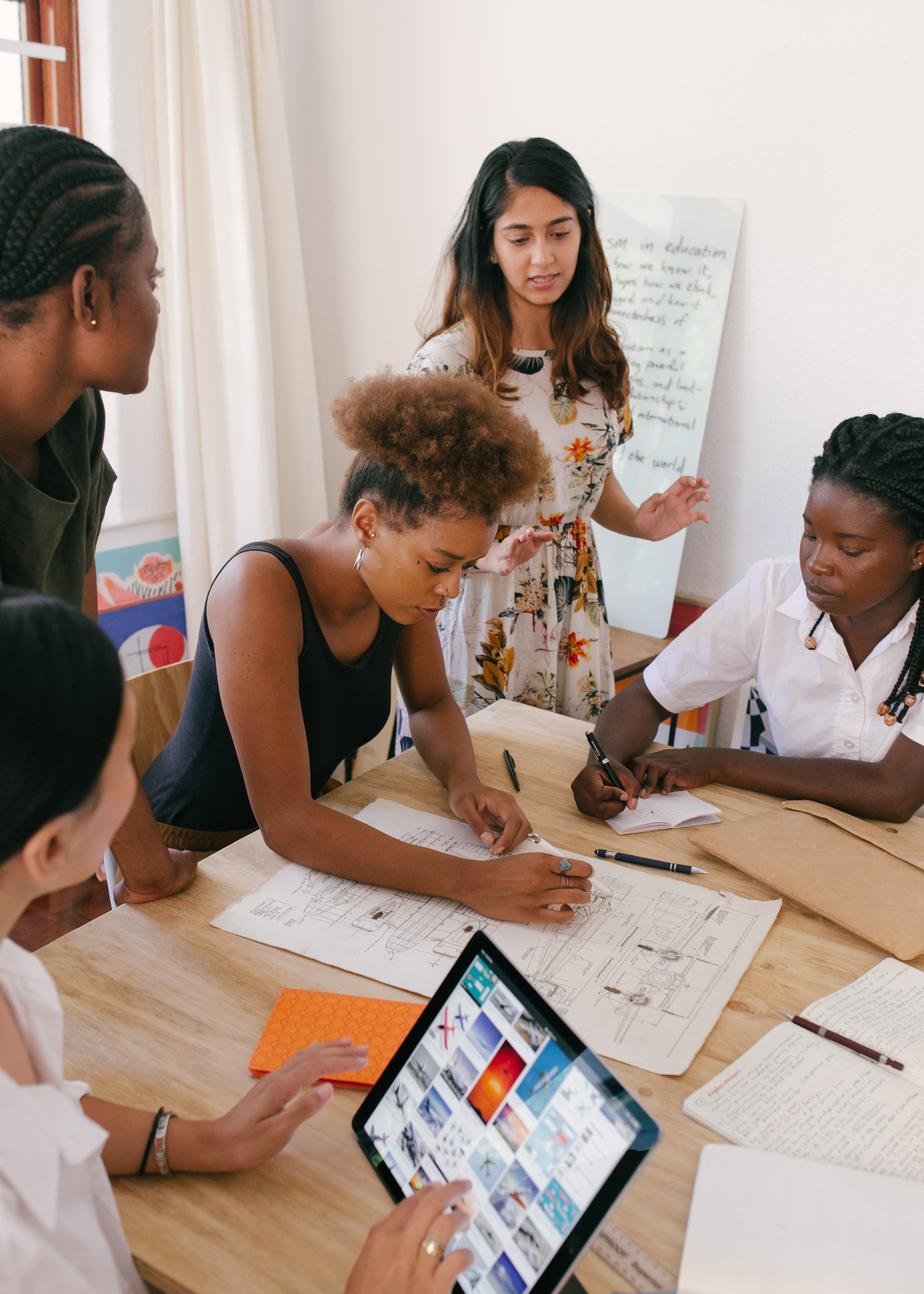 Women in a classroom working together at a table
